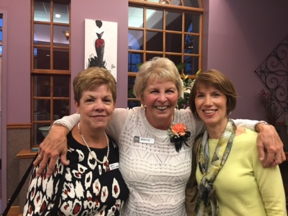 Nancy Riccio (middle) congratulated by her former assistants