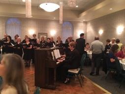 Carolyn Russell accompanies Alumni Chorale